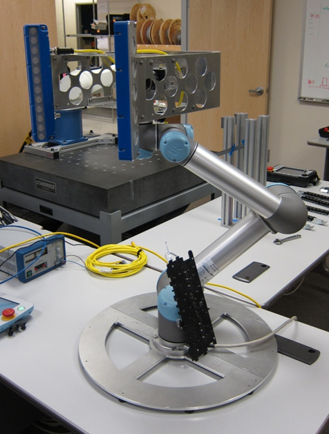 A UR5 robotic arm with an optical scanner.